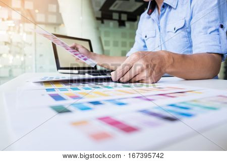 interior design or graphic designer renovation and technology concept - woman working with color samples for selection.