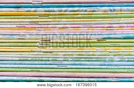close-up of old colorful notebook spine with staples background