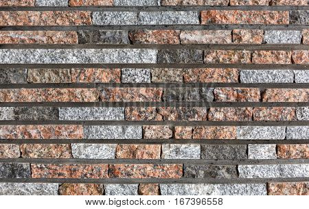 Modern decorative colored stone wall background. Brick wall style stucco texture pattern, building facade