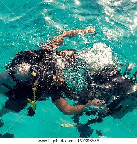 Couple divers plunged into the ocean on a sunny day top view