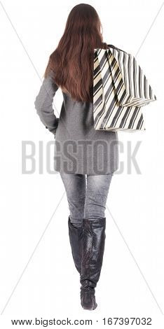 back view of going  woman  with shopping bags. beautiful brunette girl in motion.  backside view of person.  Rear view people collection. Isolated over white background.