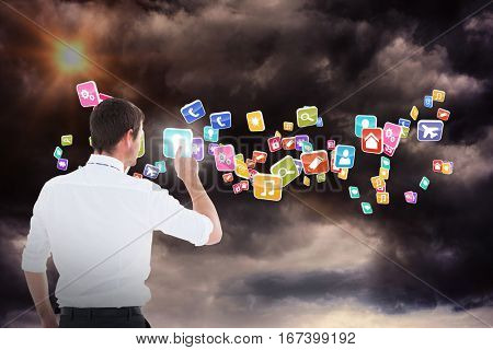 Handsome businessman pointing at a copy space against gloomy sky 3d