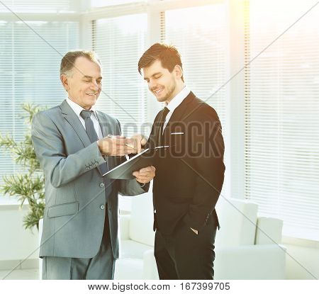 Two business partners at business meetings analyzes important documents in a bright sunny day