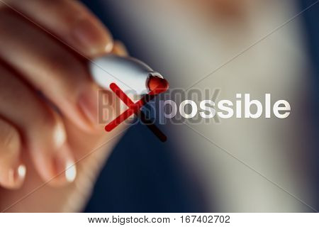 Making the impossible possible with red marker pen business concept