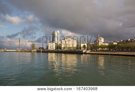 NOVOROSSIYSK, RUSSIA, MAY 9, 2015: The waterfront lit by the setting sun