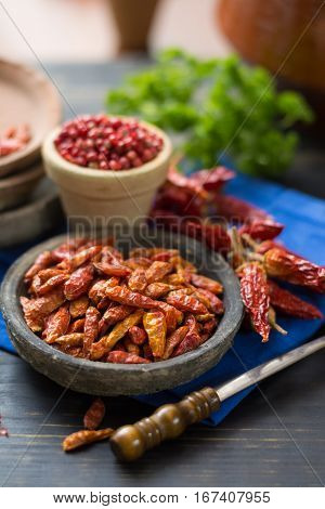 Red hot chili cayenne peppers dried variety - spicy ingredient on wooden table