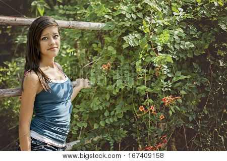 happy young woman posing in a sunny summer day