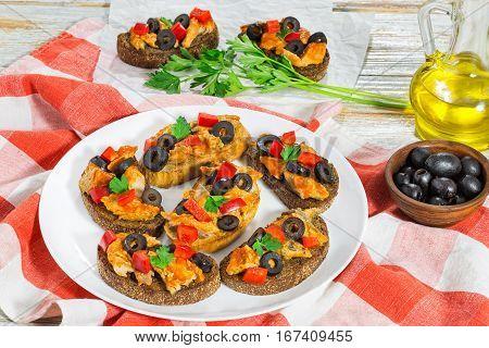 Whole Grain Rye Crostini With Pieces Of Mackerel Fish