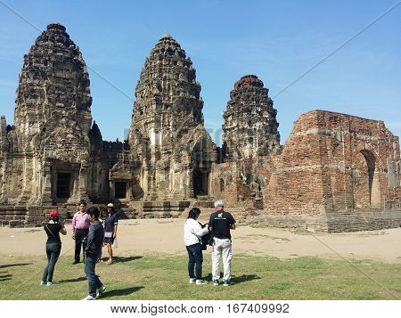 Lop Buri Thailand on January 15 2017: Seven tourists who visit Phra Prang Sam Yod in the historic downtown district Thailand.