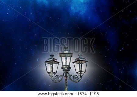 Antique candelabrum lantern against a beautiful starry sky.