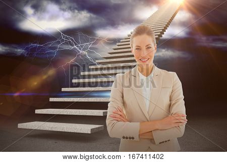 Portrait of a young businesswoman with arms crossed smiling against thunderstrom over landscape 3d