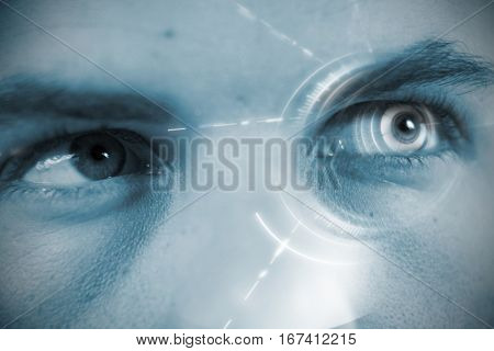 Digitally generated image of volume knob against close up of man looking away