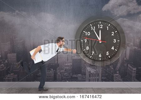 Aerial view of a city on a cloudy day against composite image of geeky young businessman running late