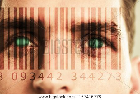 Composite image of Bar code against close up of man eyes