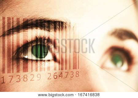 Composite image of Bar code against close up of woman with brown eyes