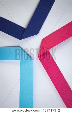 abstract background composition of colored paper ribbons