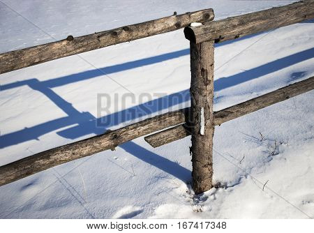 seasonal abstract background Wooden fence in winter