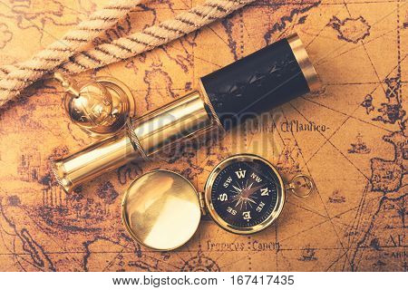 vintage navigation equipment on old world map. top view