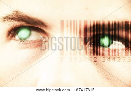 Composite image of Bar code against close up of man looking away