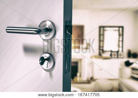 Closeup of wooden door with metallic doorknob against view of living room