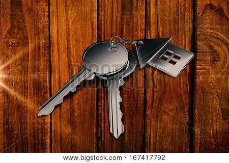 Metal key with ring against overhead of wooden planks