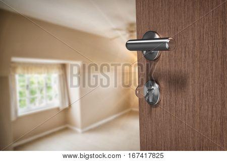 Brown door with key against empty master bedroom in cream and beige