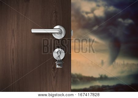 Brown door with house key against mountain against overcast sky
