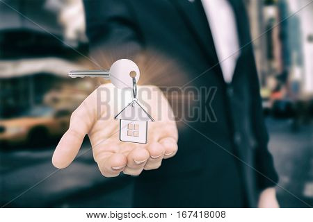 Silver key with ring against blurry new york street