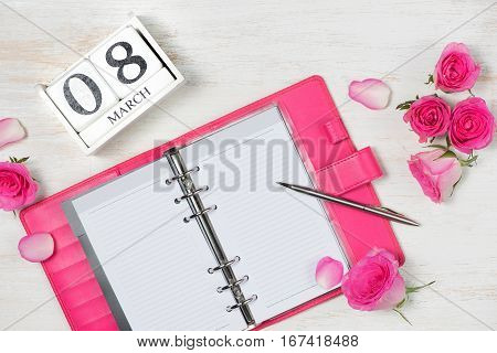 View from above with copy space. Background for woman day 8 March. White wooden table.