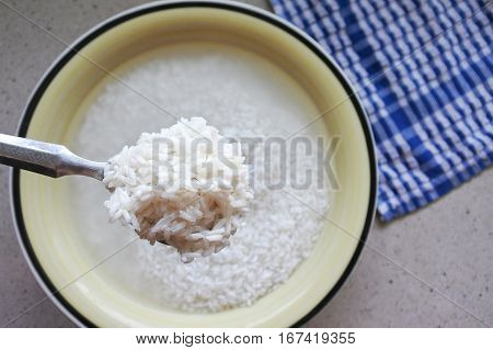 Flat Lay View Of Spoon Full Of White Ric