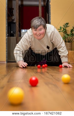 Mentally Disabled Woman Playing With Balls, Learning And Fun