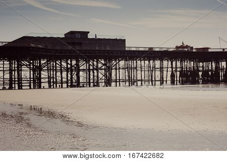 The silhouette of the new Hastings pier which was rebuilt and open to public in 2016 photo against the sun special effect filter applied East Sussex. England