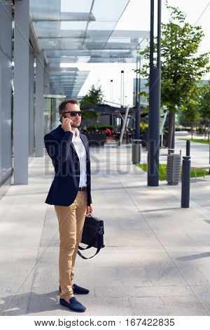 Businessman Walking Down The Street With A Briefcase