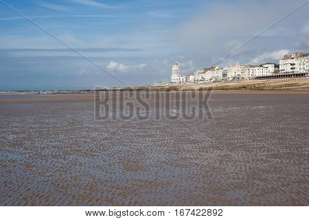 Hastings sea front in a low tide East Sussex England view to the west of the pier selective focus