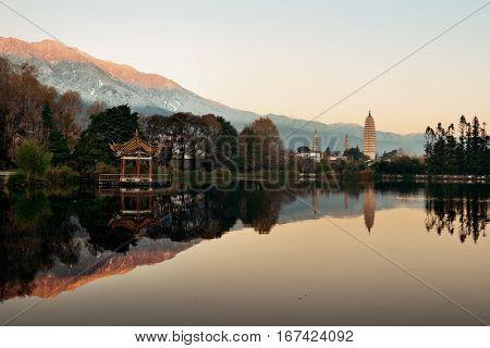 Dali Three pagoda and lake reflection at sunrise in Yunnan, China.