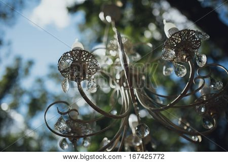 Beautiful Vintage chandelier hanging on the street
