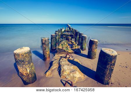 Old Breakwater In Baltic Sea At Sunset, Long Time Exposure