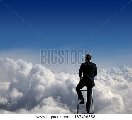 Businessman standing on ladder high in sky. Business concept.