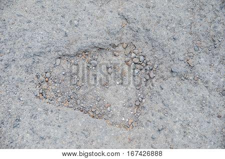 dangerous pothole in the asphalt highway,  close up