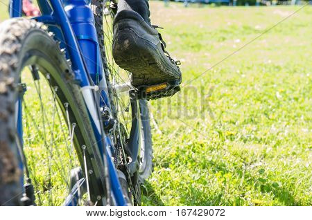 foot on pedal of bicycle close up