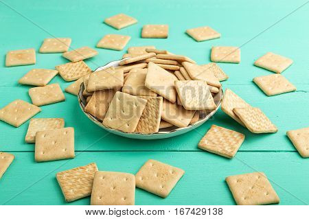 light delicious breakfast crispy crackers on a plate on a wooden background