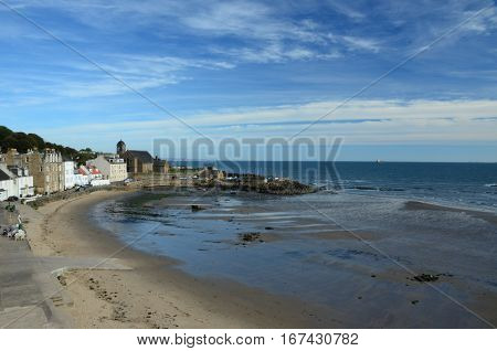 A view of the beach and harbour at Kinghorn