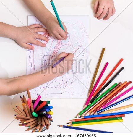 sheet of paper and hand of child kid boy girl ready to drow. Flat lay