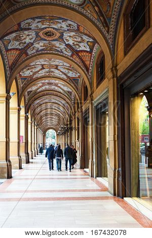 People In Arcade On Piazza Cavour In Bologna