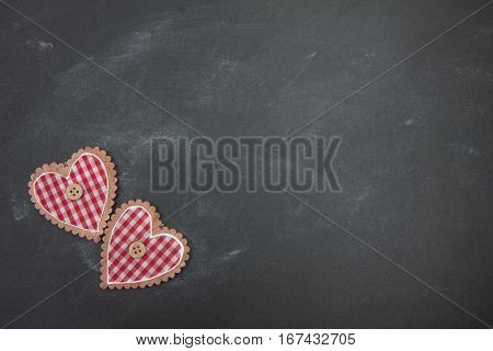 Black Chalk Board And Two Red Checkered Heart
