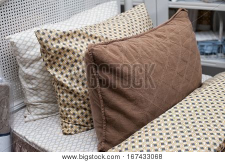 three pillows with pillowcases on the bed in bedroom