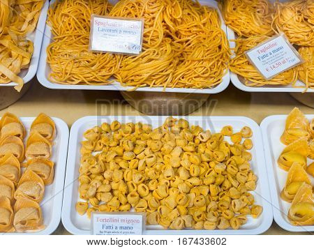 BOLOGNA ITALY - NOVEMBER 5 2012: traditional local fresh pasta in small shop in Bologna city. Fresh pasta (pasta fresca) are made from flour and eggs they are very popular in Emilia-Romagna region