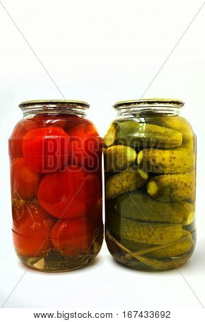 Home canning. Canned vegetables in glass jars on a white background