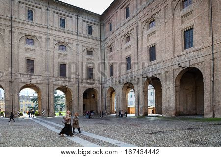 People In Palazzo Della Pillotta In Parma City