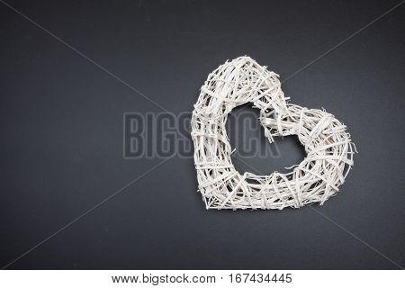 White Wicker Rattan Heart On Blackboard. Postcard To Valentines Day